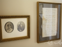 Family photos and documents framed for unique accents